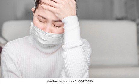 Asian girls wearing white jersey protective mask, cough, headache, chest pain.Health care concept