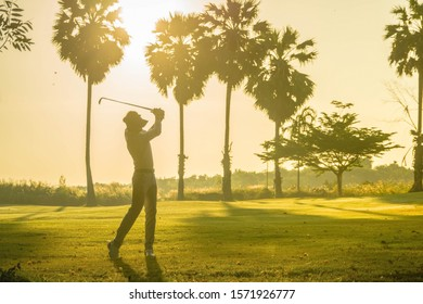 Asian golfers are playing golf on the golf course.Golfers playing golf.