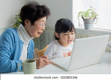 asian grand mother spending time with her grandchild