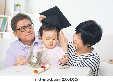 asian grand parents with grand daugther education saving concepts