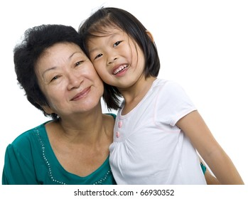 Asian grandmother and grandchild on white background