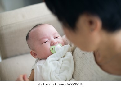 asian grandmother and her grandchild