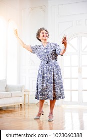 Asian grandmother loving to dance, happy expression