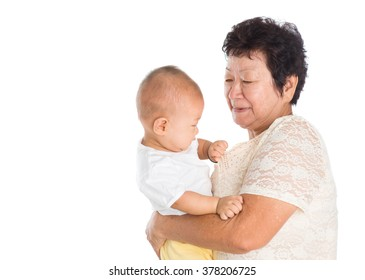 Asian grandmother taking care grandchild, isolated on white background.