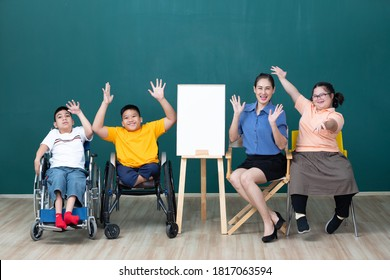 asian group of disabled kids or autism child and woman teacher cheering form success in art class