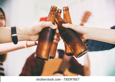 Asian group of friends having party with alcoholic beer drinks and Young people enjoying at a bar toasting cocktails.soft focus