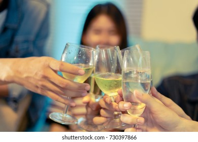 Asian group of friends having party with alcoholic beer drinks and Group people with champagne dancing at party.soft focus