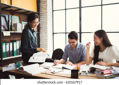 Asian groups are brainstorming, working in the office, reviewing lessons, doing homework in the university, group concept.