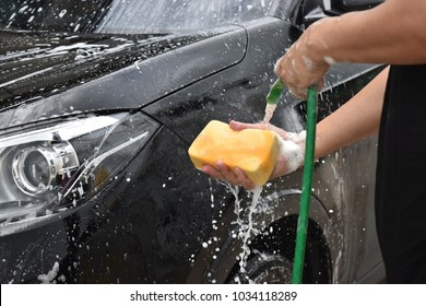 Asian guy is about 40 years old wearing casual wear.