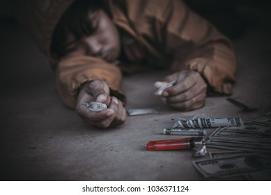 Asian guy hooked faint because of a drug overdose.world anti drug day concept,narcotics cause death.
