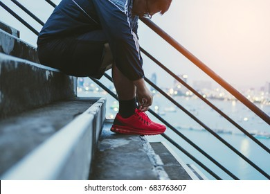 Asian Guy Tying Running Shoe, Preparing for Running for Dieting, exercising to lose weight