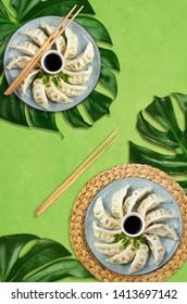 Asian gyoza dumplings on leaves