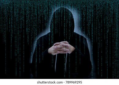 Asian hacker in black hood with matrix background
