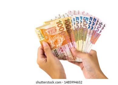 asian hand hold hong kong banknotes money