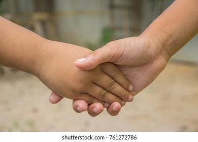 Asian kid's hands shake