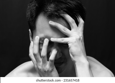 asian handsome man in black and white emotion portrait photo. feel sad, headache, alone on dark background