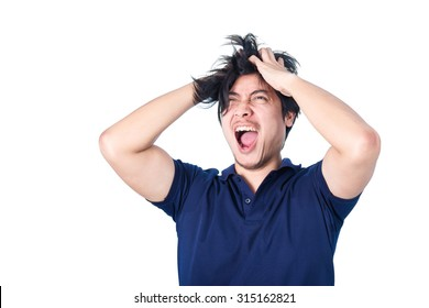 Asian handsome man holding his head frowning with worry screaming. Man pulling his hear for worry, sadness, desperation, so serious, funny, isolated on white background