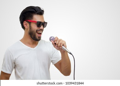 Asian handsome man with a mustache, smiling and singing to the microphone isolated on white background