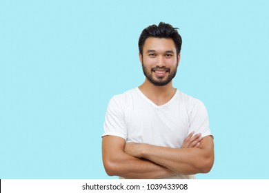 Asian handsome man with a mustache, smiling and laughing isolated on blue background