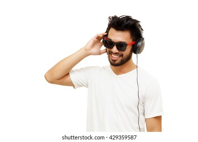 Asian handsome man with a mustache, smiling and laughing listen music with headphones isolated on white background