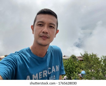 Asian handsome man take a photo and must background