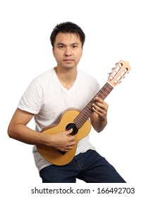 Asian handsome musician play classic guitar isolated