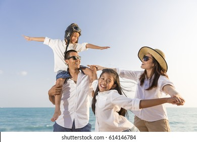 Asian happy family enjoy relaxing on the beach, Concept of happy family and lifestyle,Concept of happy family travel