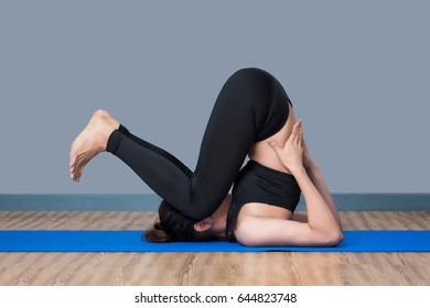 Asian healthy woman exercising yoga at sport gym, girl doing sport indoor.Photo design for fitness sporty woman and health care concept.