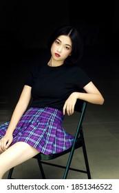 Asian high school girl with short black hair