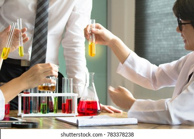Asian High School students. Group of students working at chemistry class.