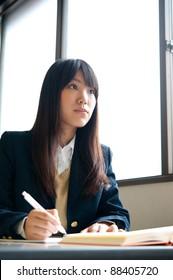 asian high schoolgirl studying in classroom