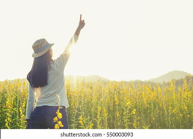 Asian hipster cute teen girl enjoying sunset on peak. Tourist traveler on background valley landscape view mock-up, sunset in trip in basque country.