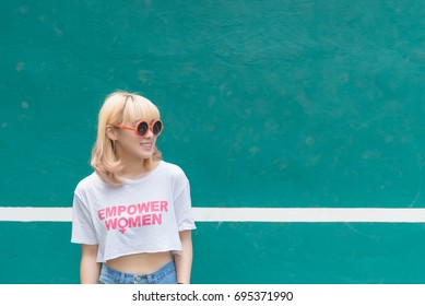 Asian hipsters girl posing for take a photo,lifestyle of modern woman,Thai people in hippie style,Golden hairs