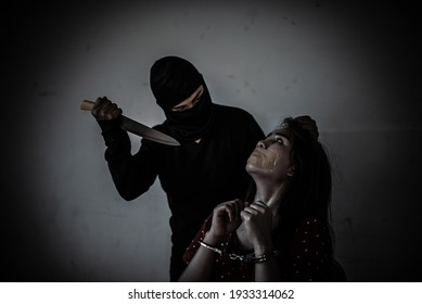 Asian hostage woman Bound with rope at night scene,The thieves kidnapped for ransom,thailand people
