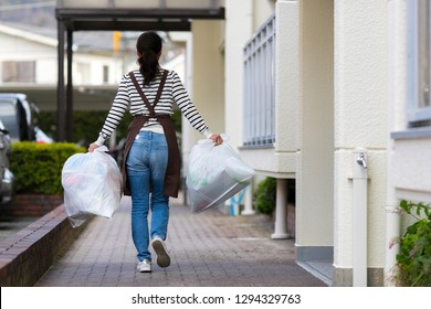 Asian housewife with garbage