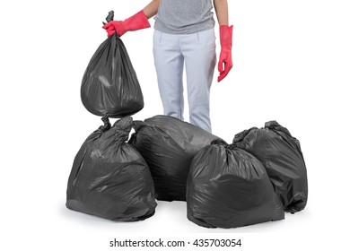 Asian housewife holding garbage bags, isolated on white background.