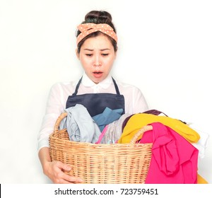 Asian housewife Wear apron, Hold a laundry basket to wash.Tired