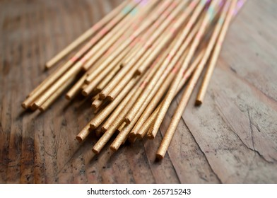 asian incense closeup on wooden background
