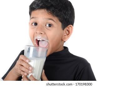 Asian indian boy drinking milk