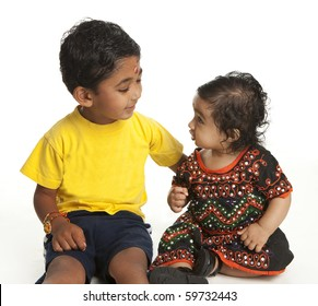 Asian Indian Brother and Sister at the Traditional Hindu Festival of Rakshabandhan on White