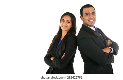 Asian Indian businessman and businesswoman in group standing with folded hands isolated on white with copy space. Successful Teamwork concept.