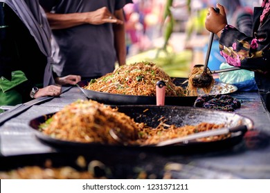 Asian, Indian and Chinese street food. Food court on local market of Langkawi island, Malaysia.Traditional asian street food.