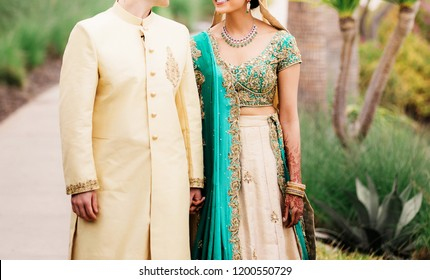 Asian indian lovebirds holding hand and  first look wedding day posing