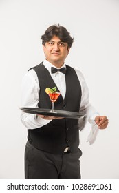 Asian Indian waiter or Bartender isolated over white background, selective focus