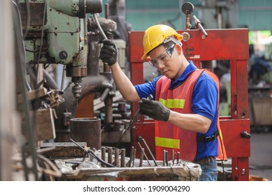 Asian Industrial workers. worker Asian in factory on the machine