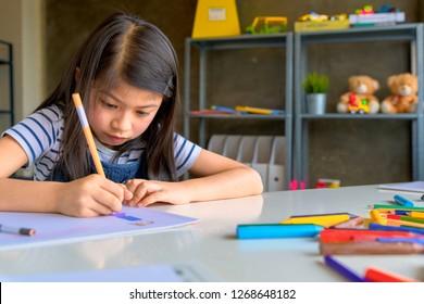Asian Kid in Creative Art workshop at school.