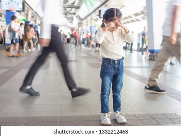 asian kid crying to lost parent or live alone on sky train station in Bangkok city,Thailand