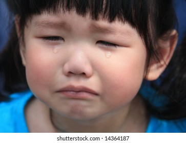 Asian kid crying in tears