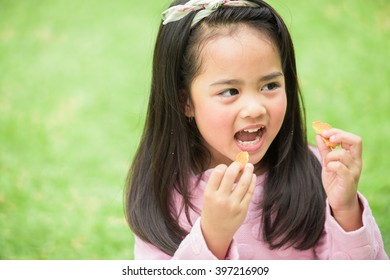 asian kid eating cookie