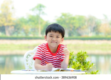 Asian kid happy with his learning at public garden